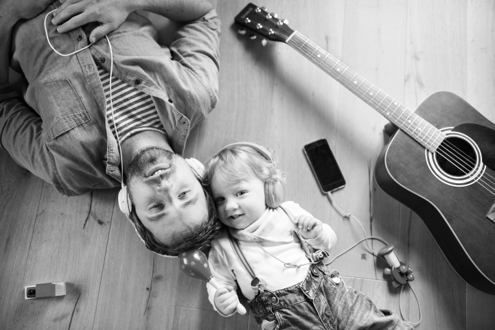 parent with their child listening to music